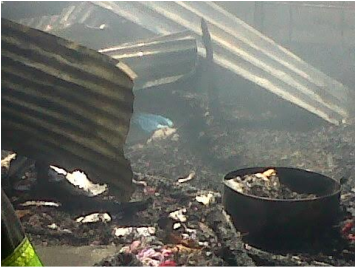 This is the remains of the house that was on fire that left the family seven homeless and without anything to console them at Slovo – Cape Town.